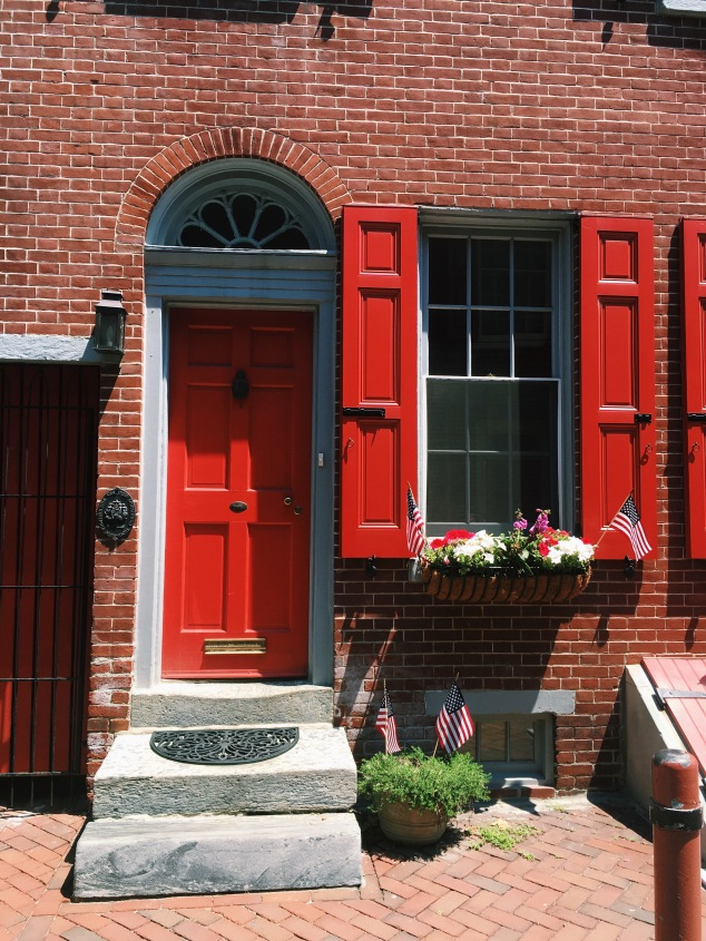 Red door and shutters in Elfreth's Alley, Philadelphia